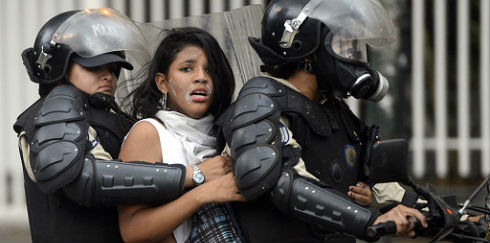 140315022033_venezuela_protests_police_512x288_afp_nocredit
